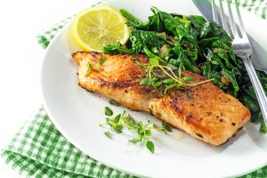 Grilled Salmon with Sautéed Spinach and Arugula